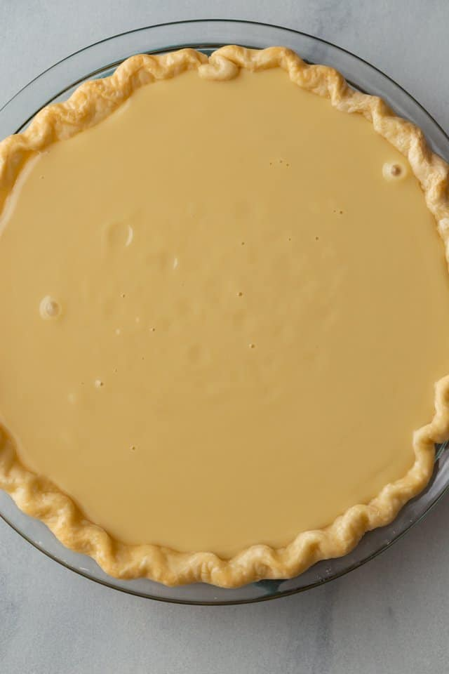 overhead view of unbaked honey pie