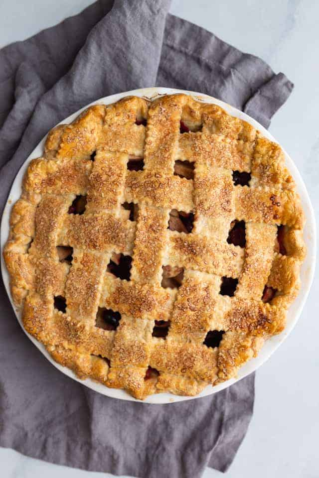 overhead view of a baked apple cranberry pie