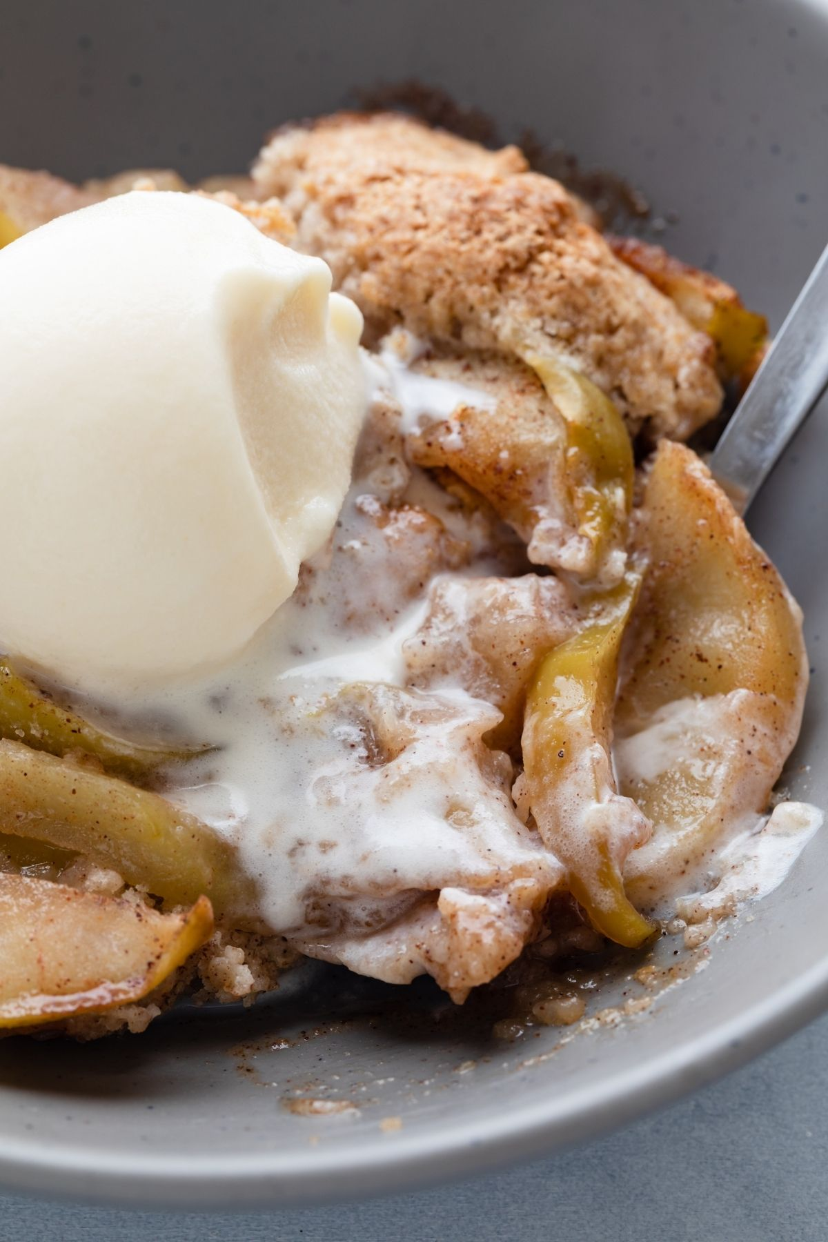 close up overhead view of apple cobbler and ice cream in a bowl