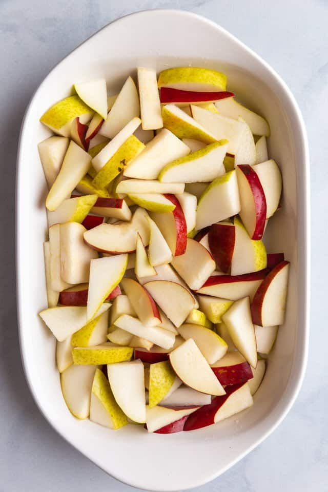 sliced pears in a white baking pan