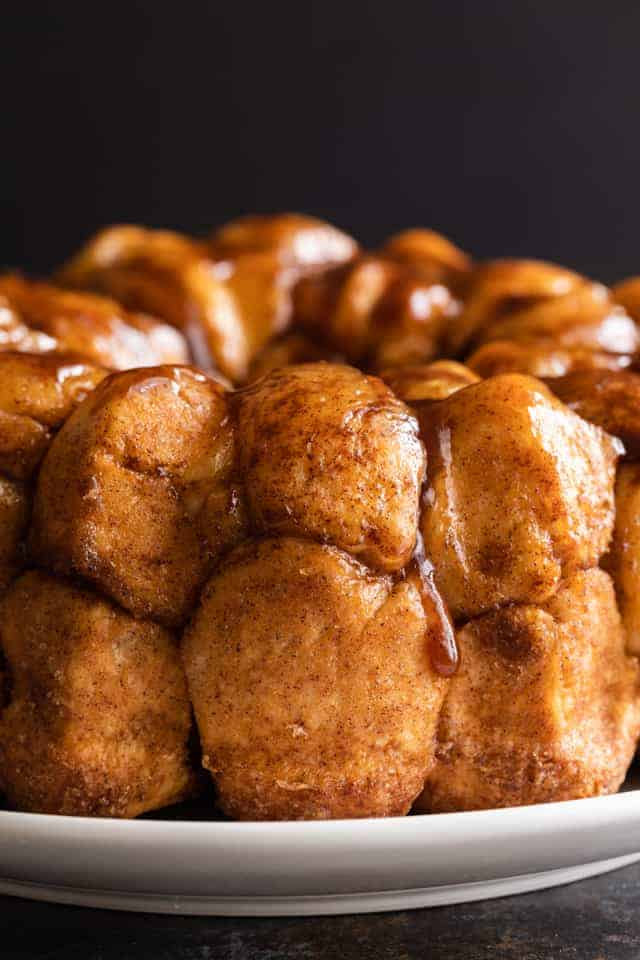 close up of gooey monkey bread on white plate