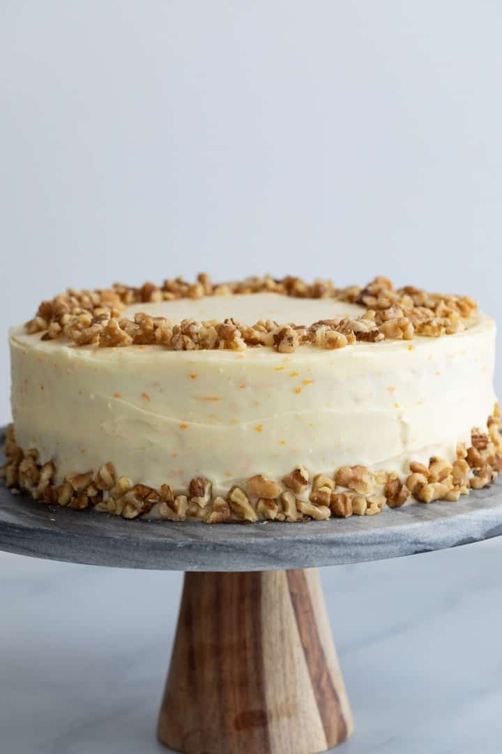 ultimate pineapple carrot cake on a grey marble cake stand
