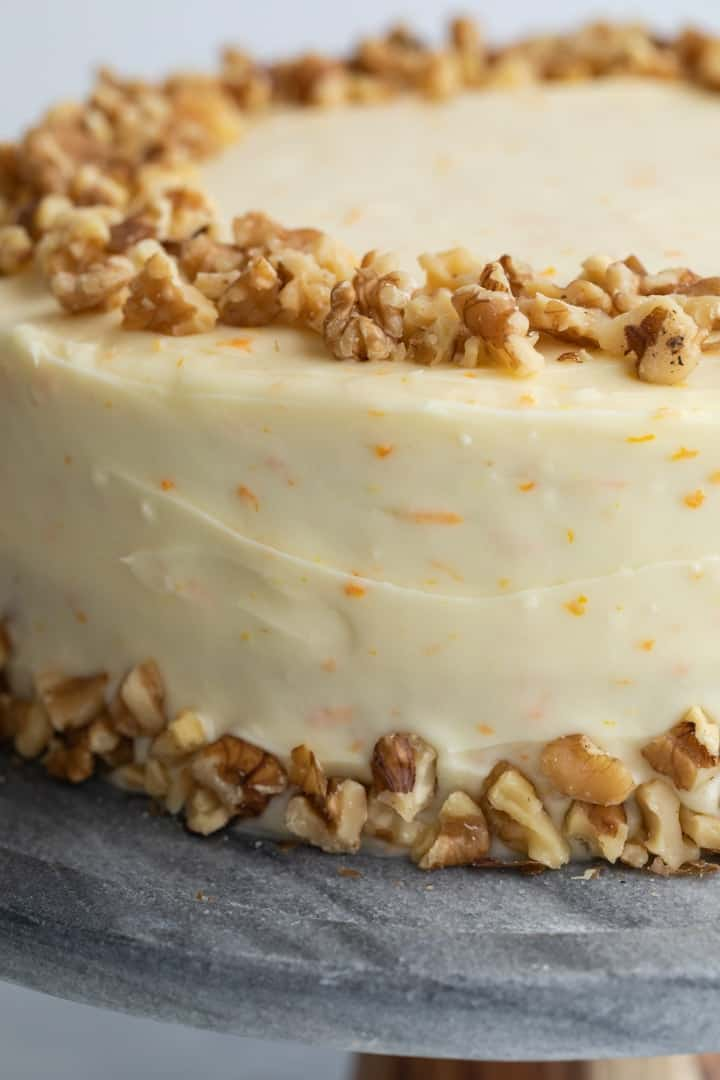 close up of pineapple carrot cake with orange cream cheese frosting