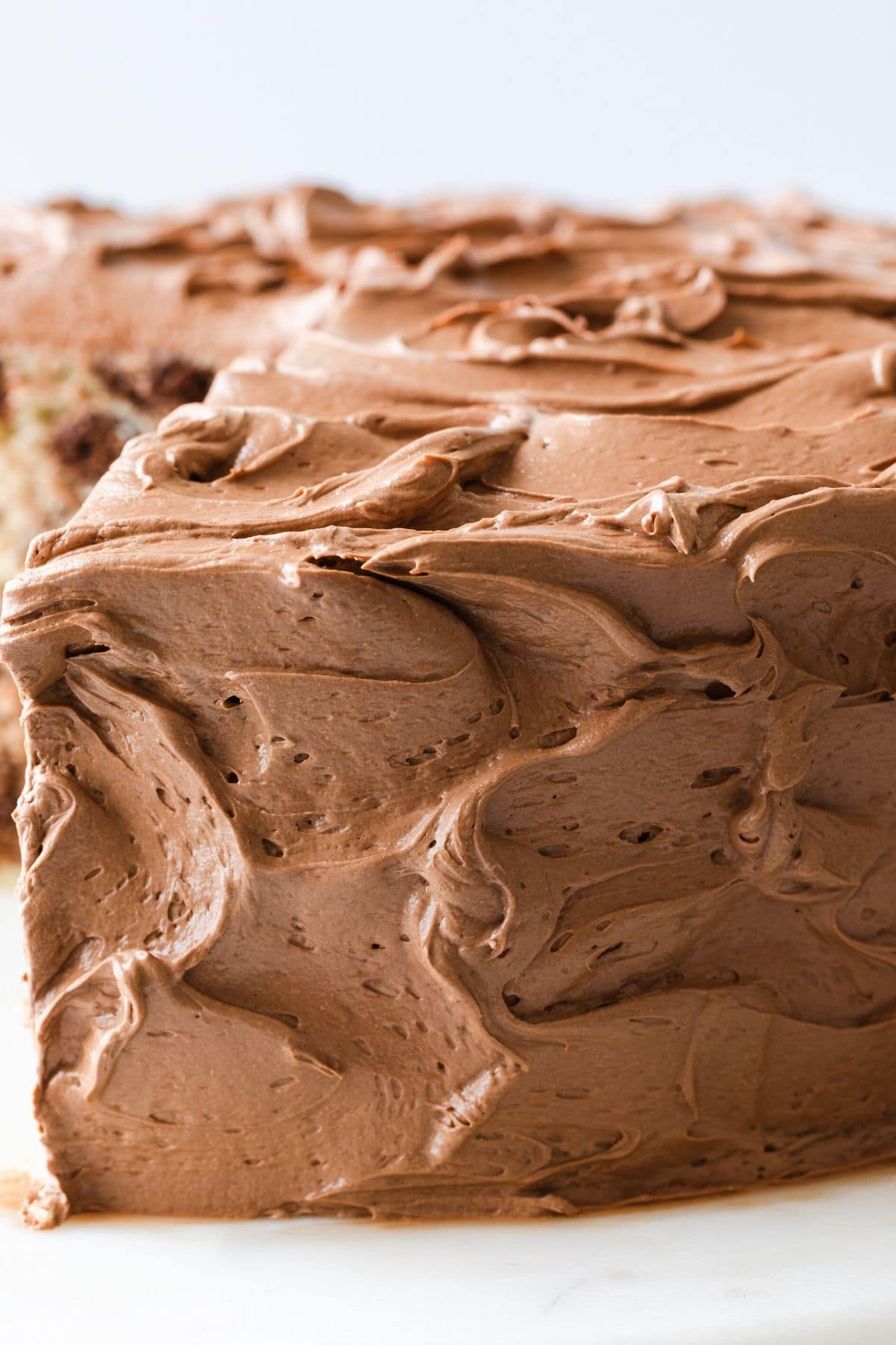 close up of whipped chocolate frosting on cake
