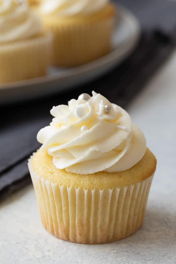close up view of the best vanilla cupcakes with vanilla buttercream