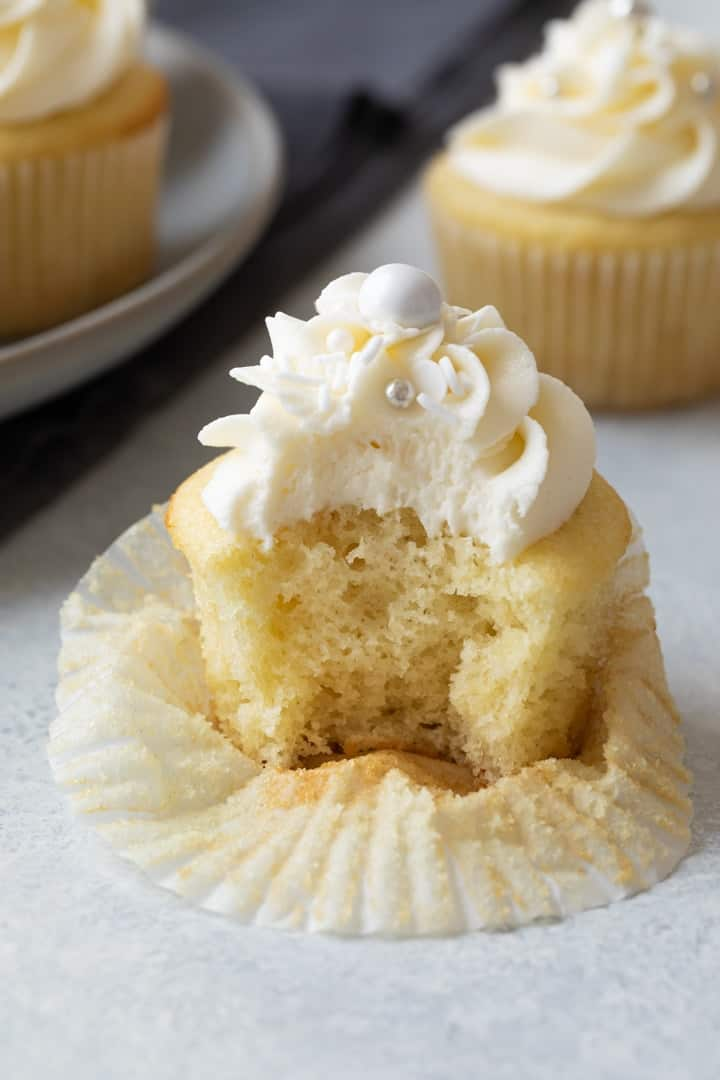 vanilla cupcake with a bite taken out