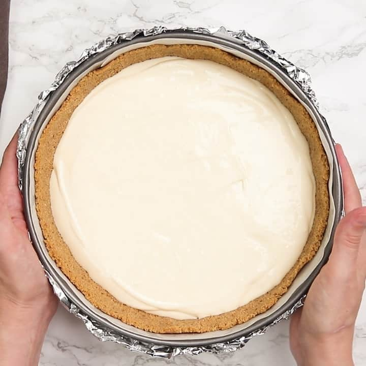 pecan pie cheesecake filling in a graham cracker crust