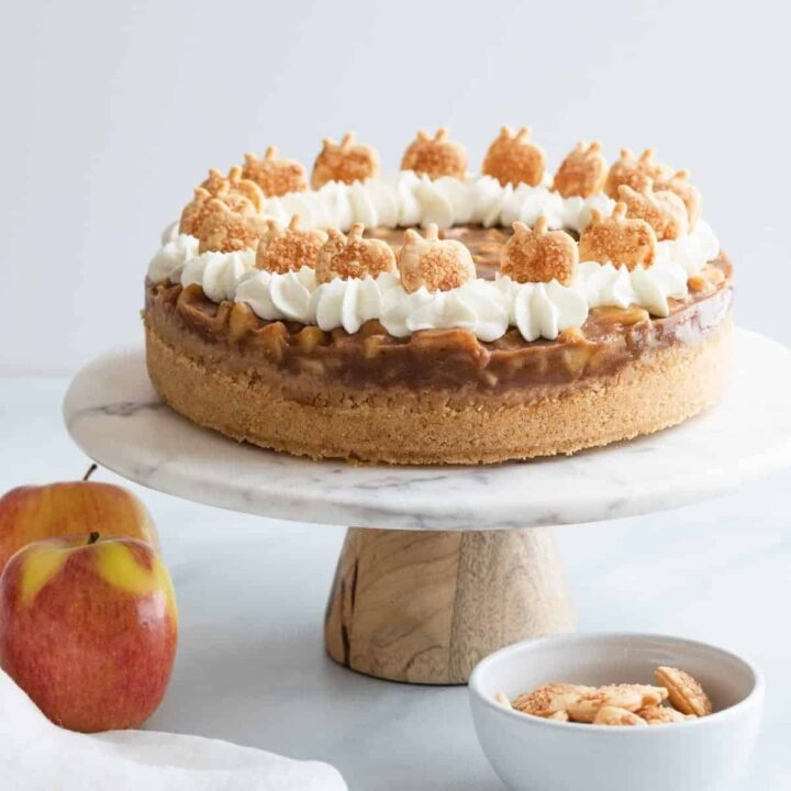 apple pie cheesecake on a marble cake stand