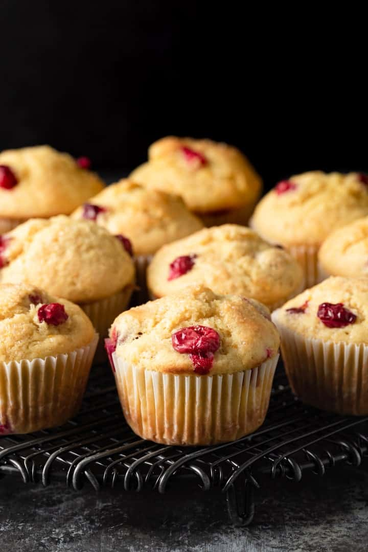 cranberry orange muffins on a cooling rack