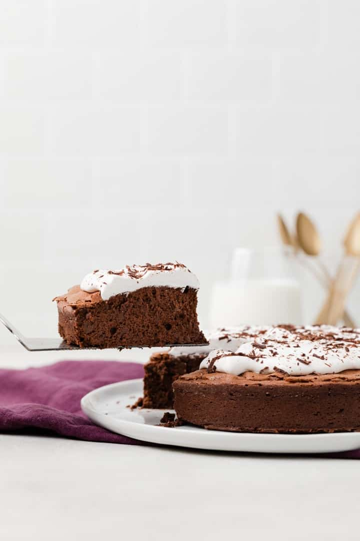 slice of flourless chocolate cake on a cake server