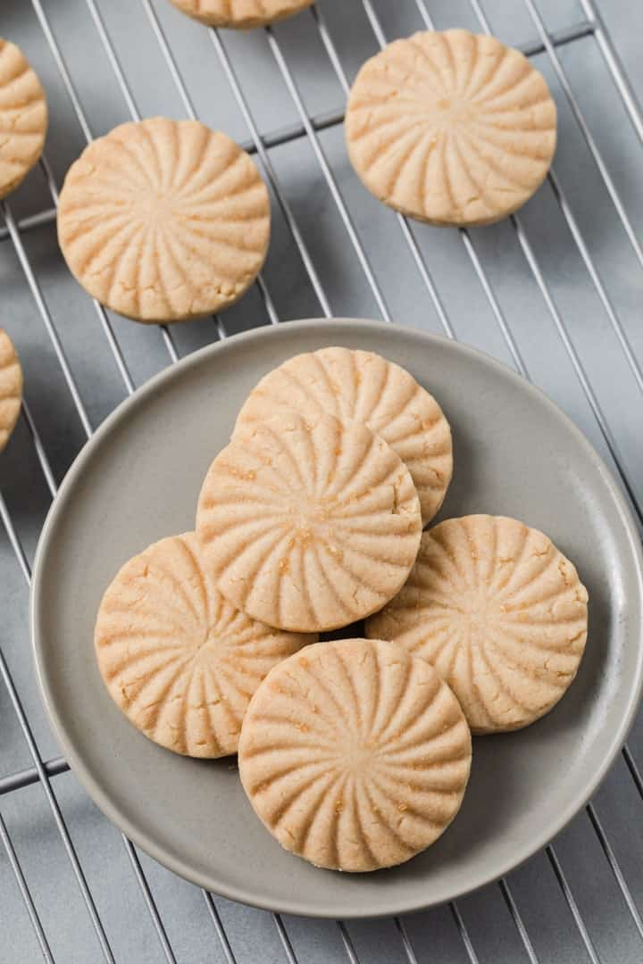 overhead of shortbread cookies on a grey plate
