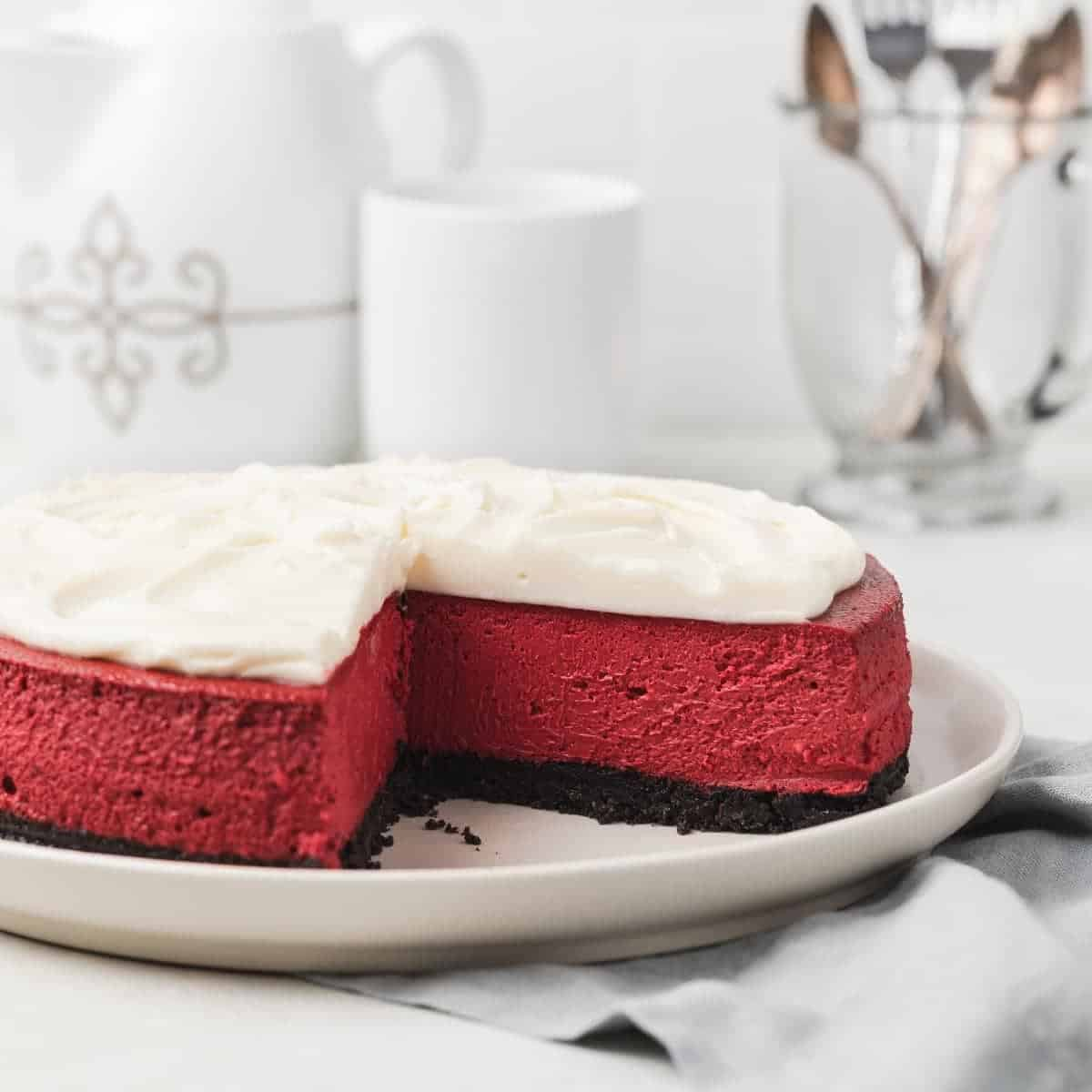 red velvet cheesecake with a slice taken out