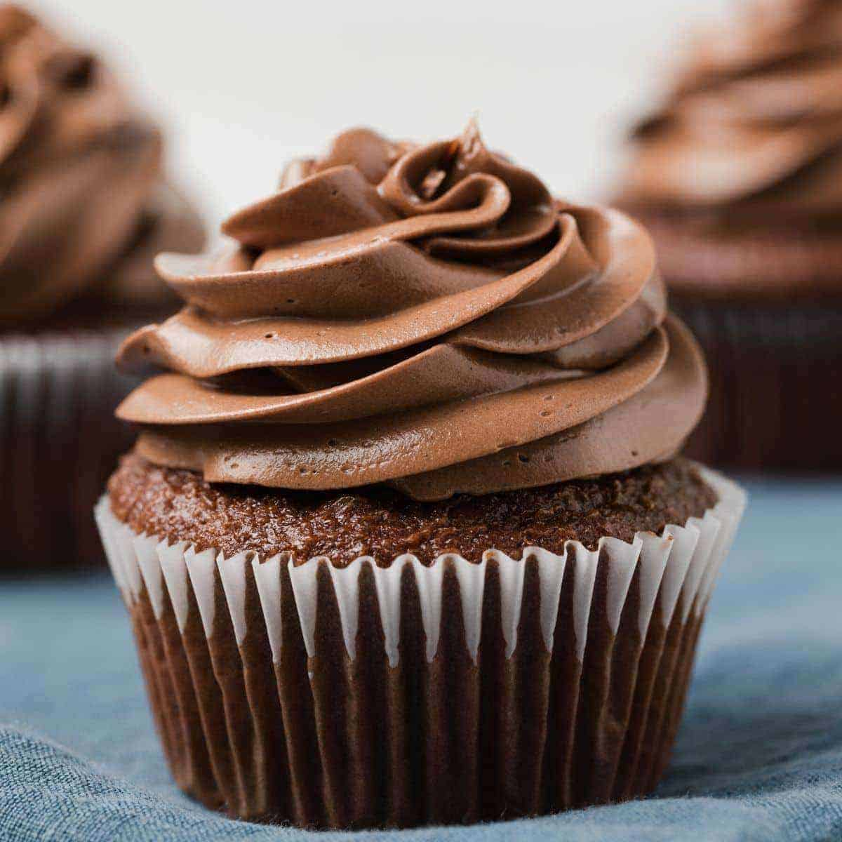 side view of chocolate cupcake with chocolate Swiss frosting