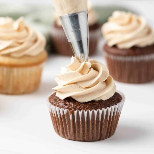 peanut butter frosting piped onto chocolate cupcake