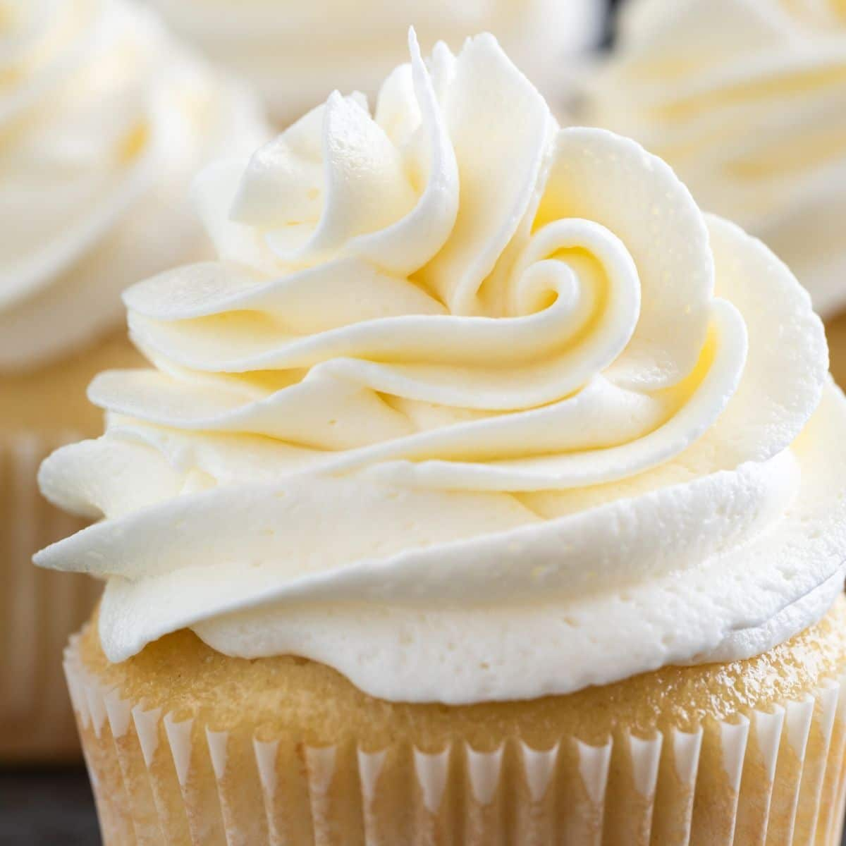 Swirl of Vanilla Buttercream Frosting on a yellow cupcake