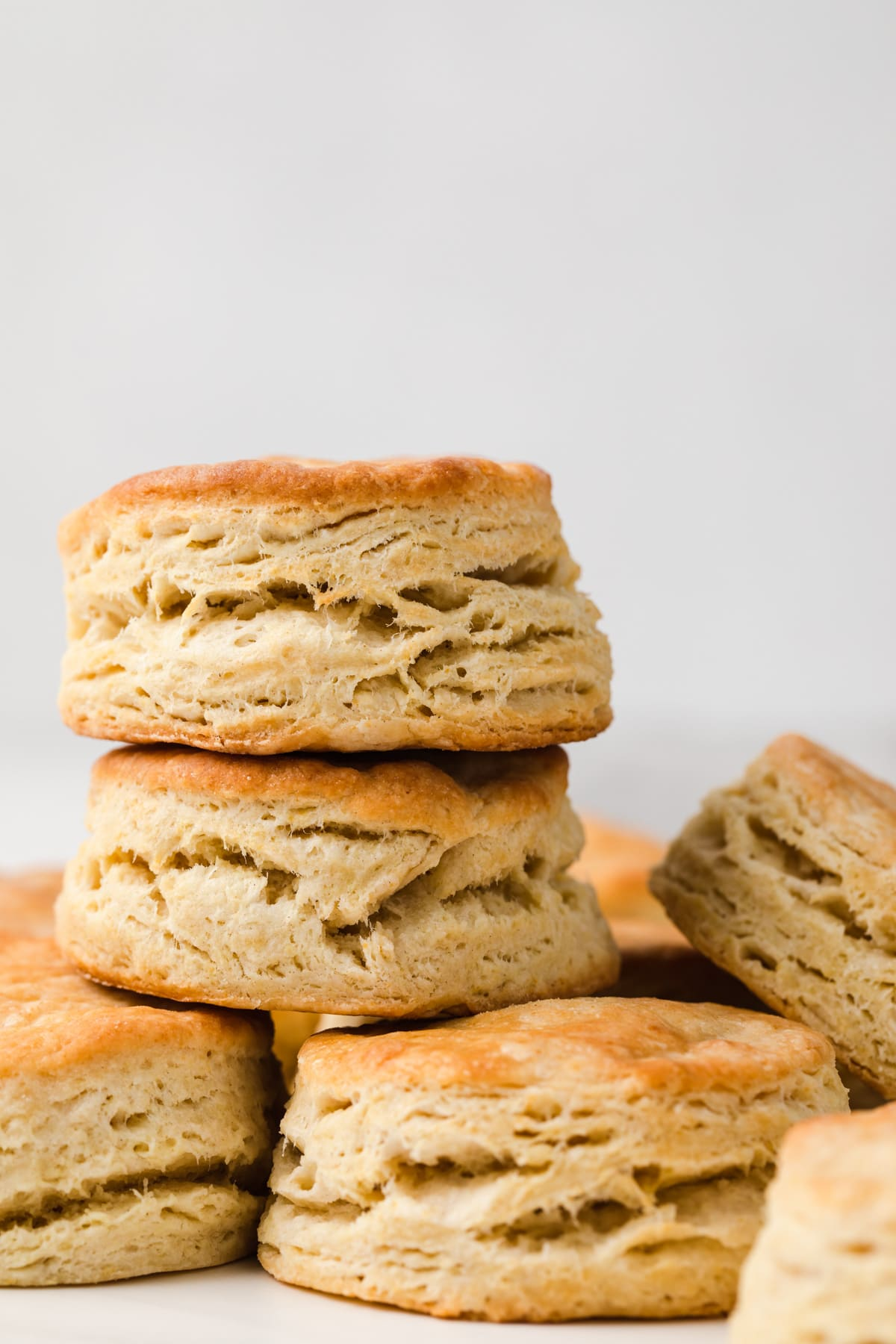 two biscuits stacked on top of single layer of biscuits