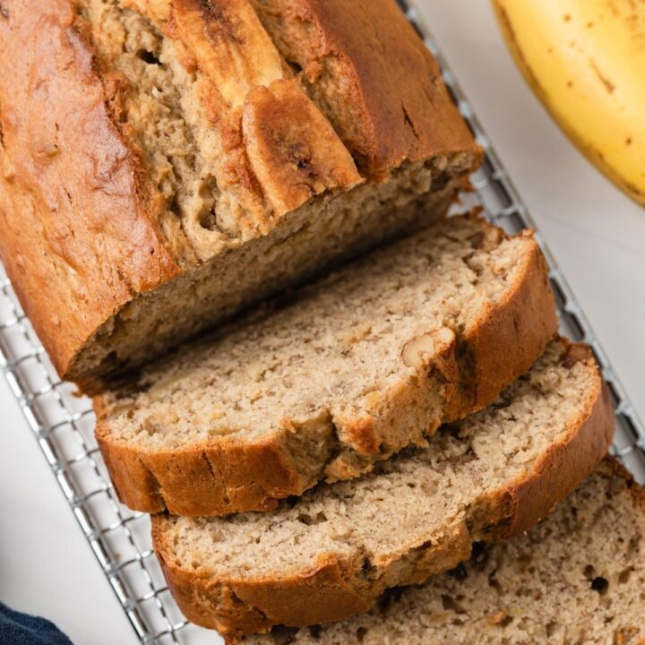 overhead of easy banana bread loaf with three slices cut out