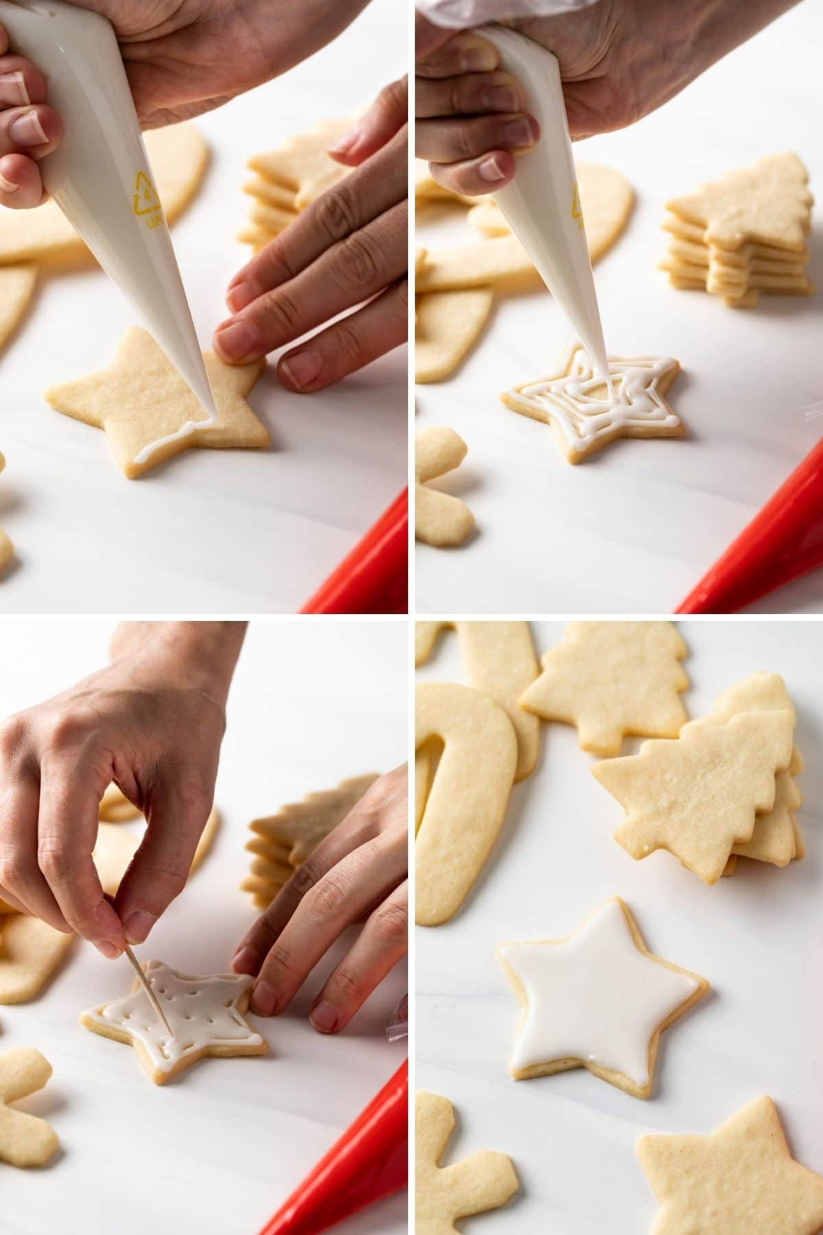 piping white icing on star shaped cookies