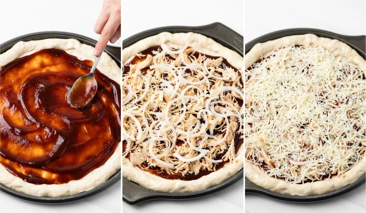 bbq sauce being spread over pizza crust with spoon, chicken and onion over the bbq sauce, and cheese spread over the top of pizza