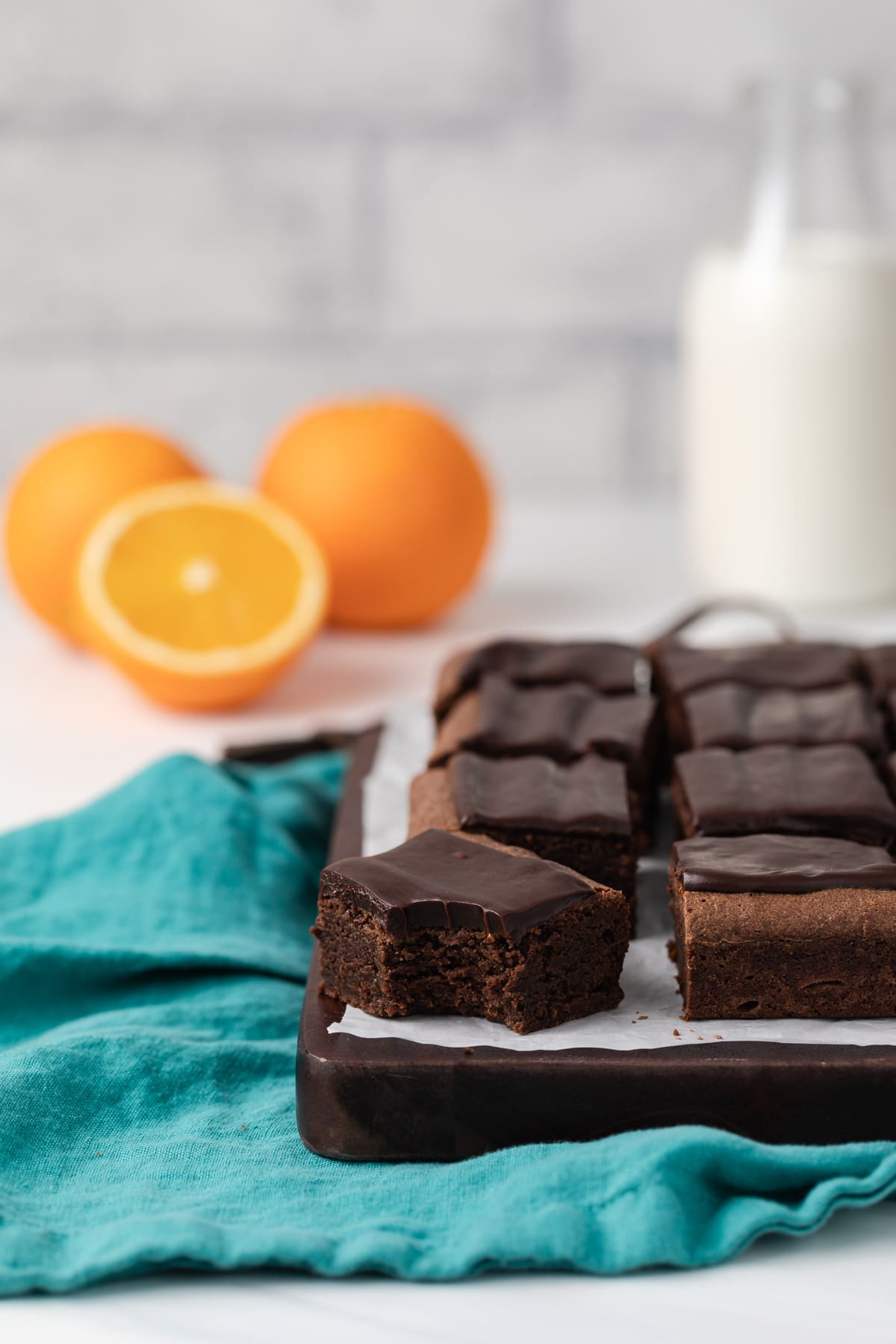 chocolate orange brownies with a bite taken out of one