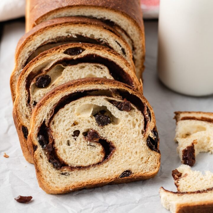 up close view of sliced cinnamon raisin bread with the interior visible