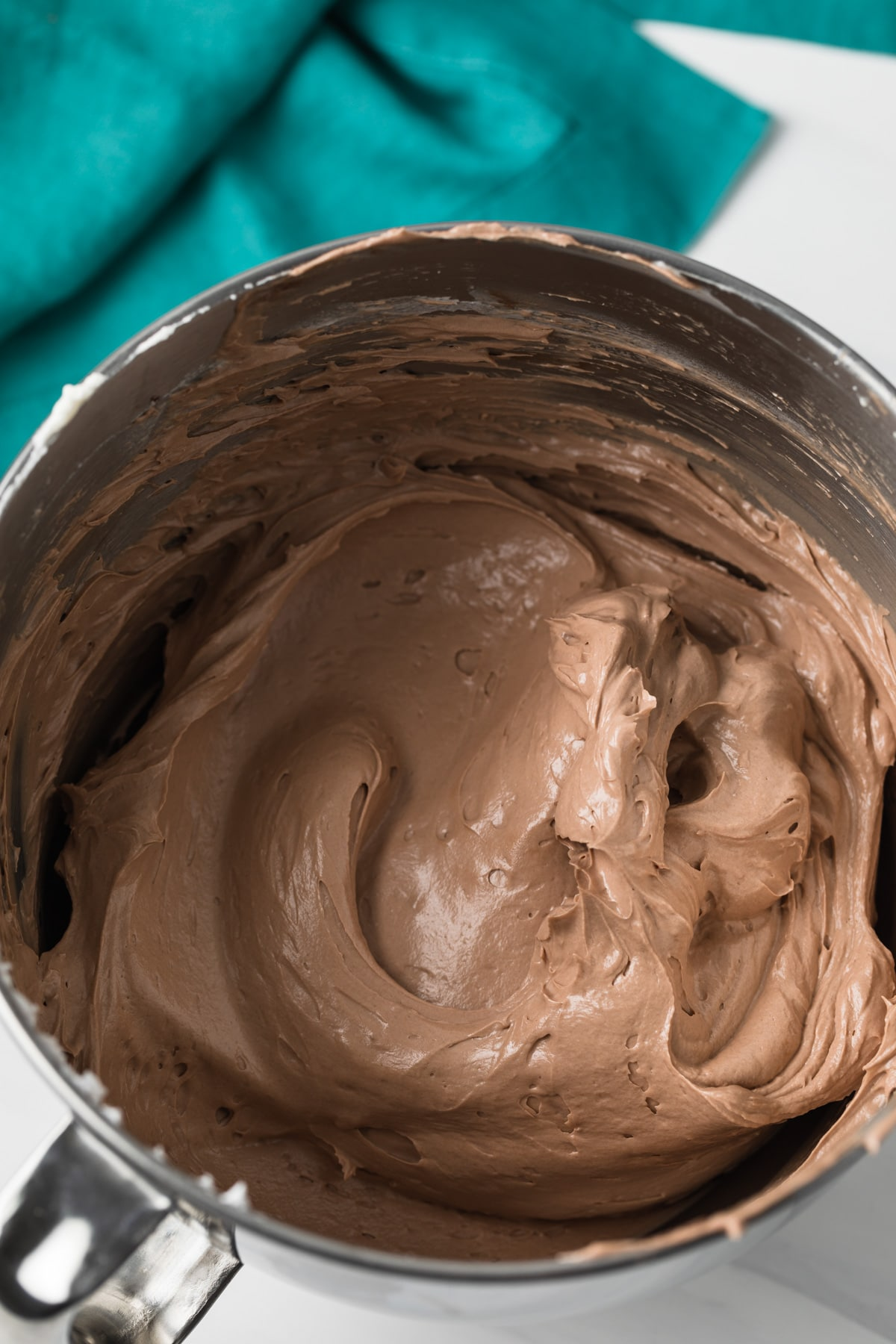 Nutella swiss meringue buttercream in stainless steel mixing bowl