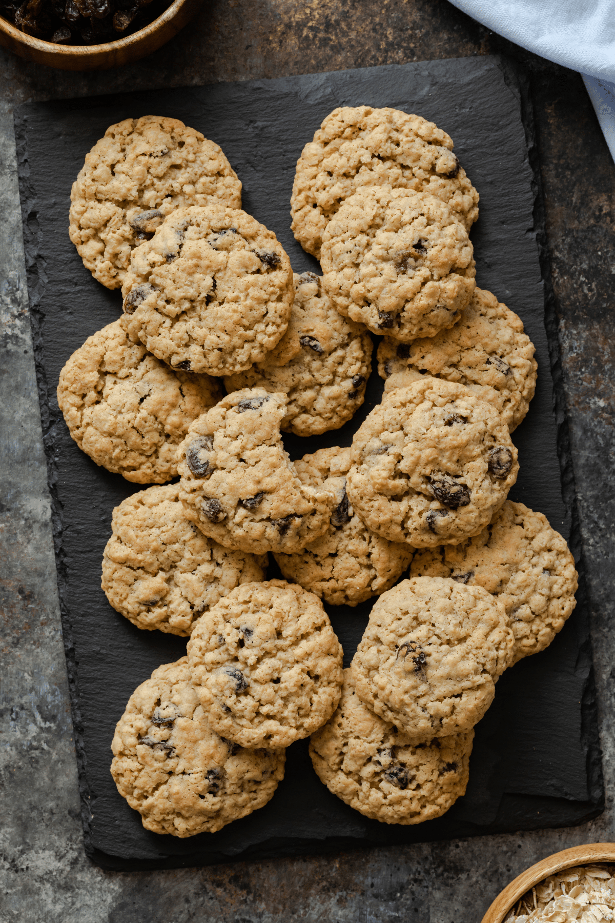 oatmeal raisin cookies scattered on a slate platter