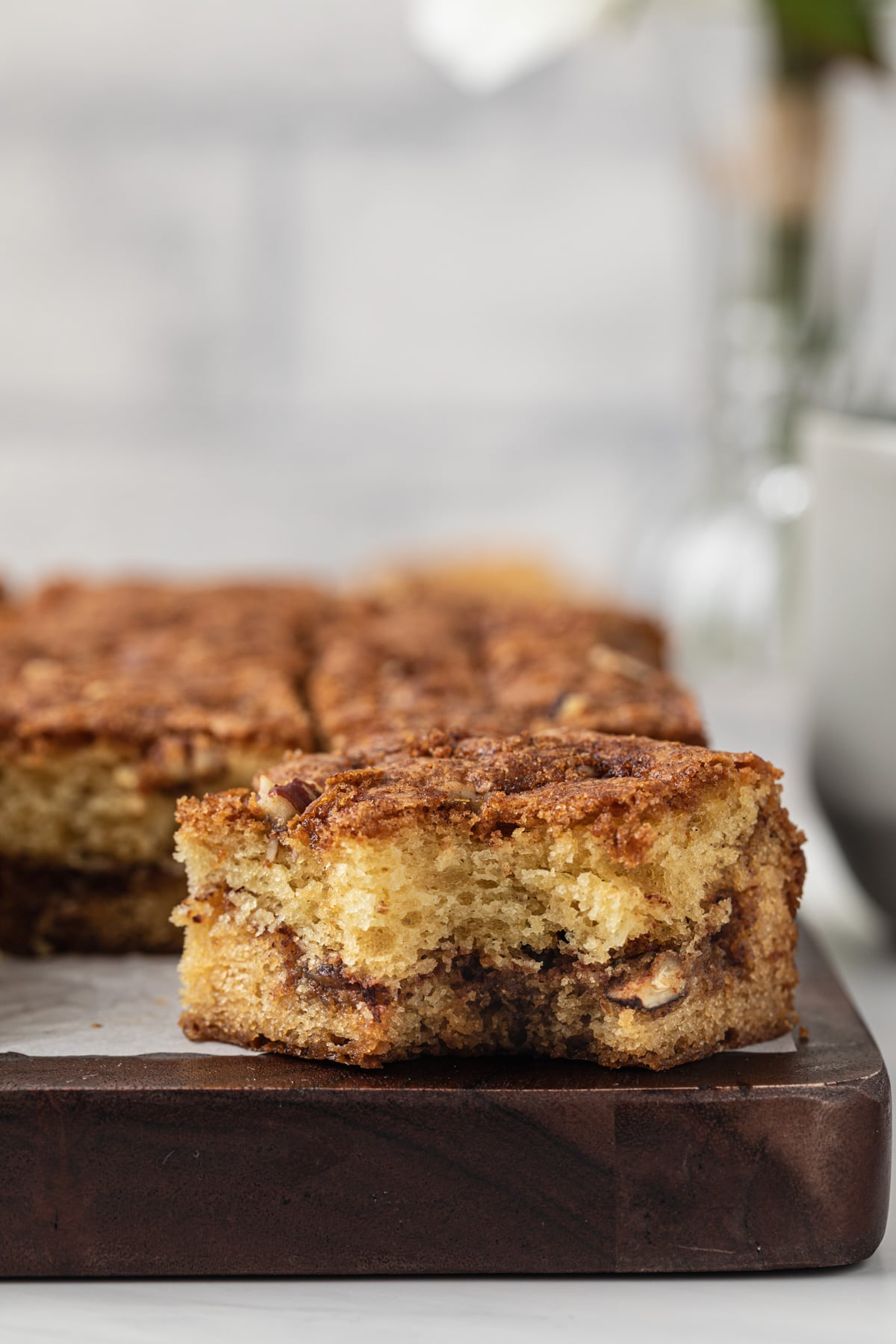 slice of cinnamon coffee cake with bite taken out
