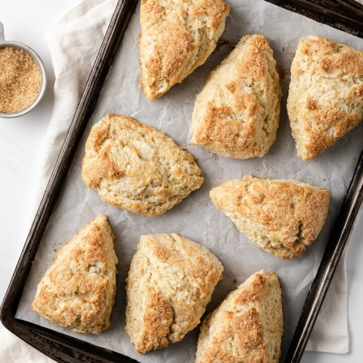 overhead view of vanilla cardamom scones on baking sheet