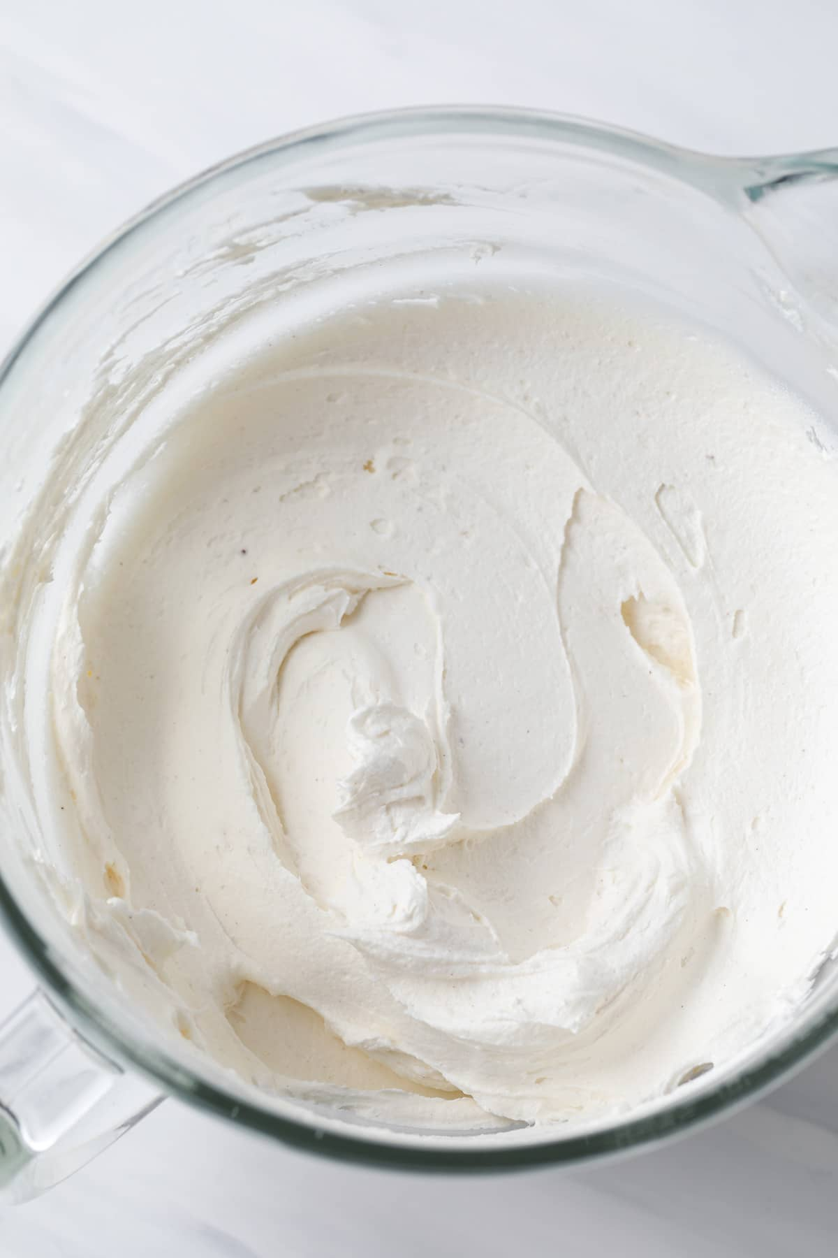 creamy brown butter frosting in glass bowl