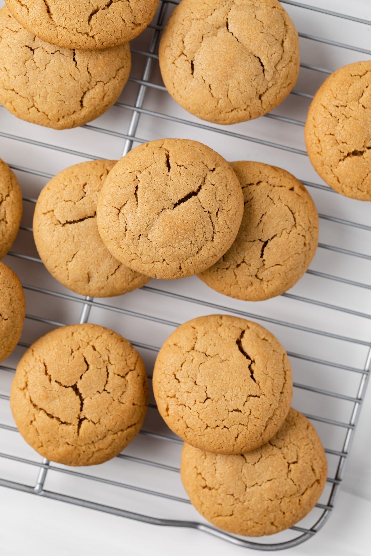 peanut butter cookies scattered on a wire rack
