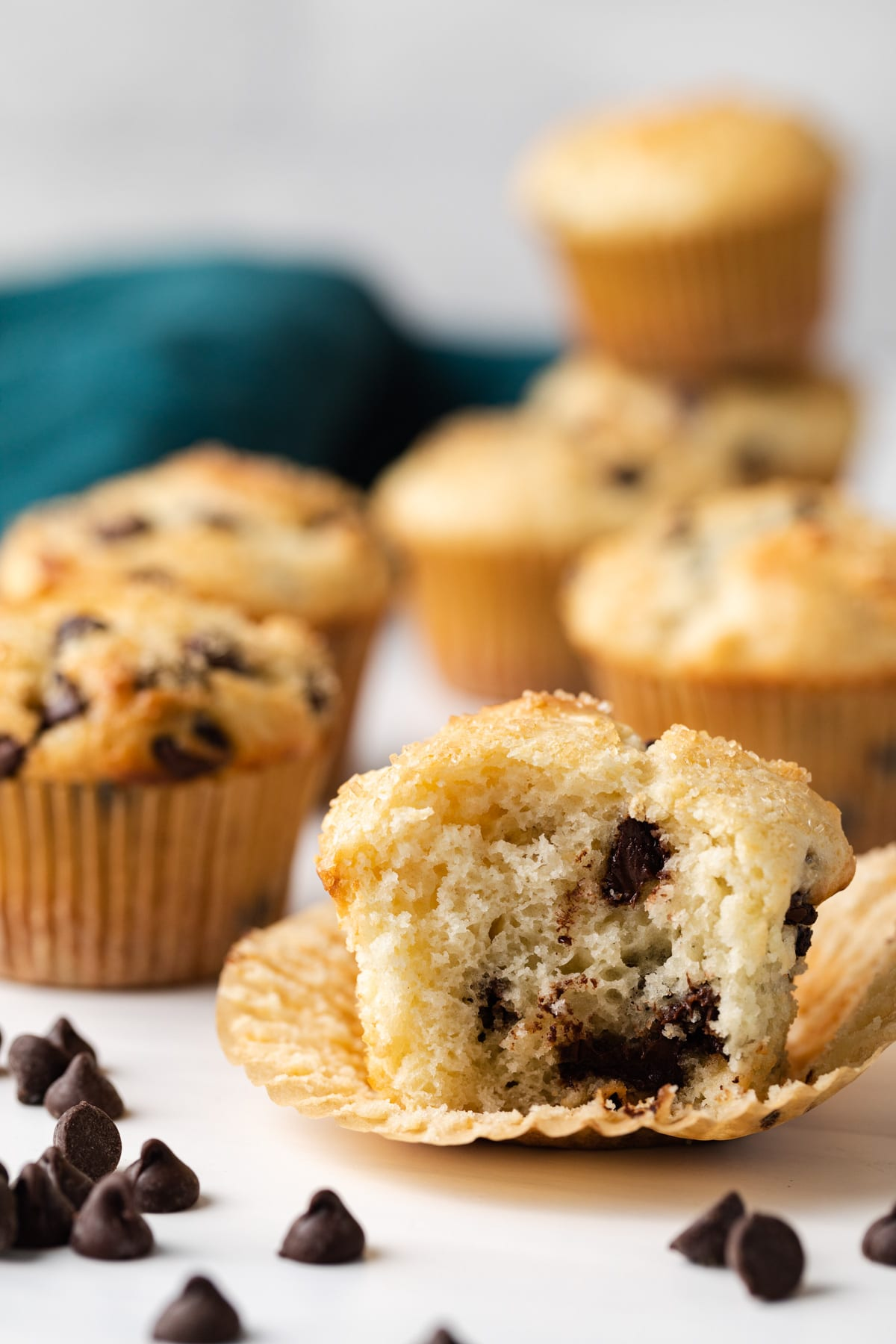 side view of chocolate chip muffin with a bite taken out so the inside is visible