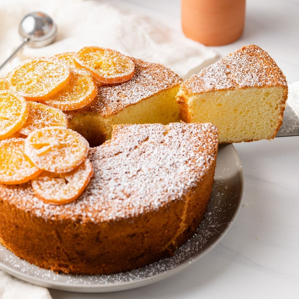 slice being taken out of orange chiffon cake