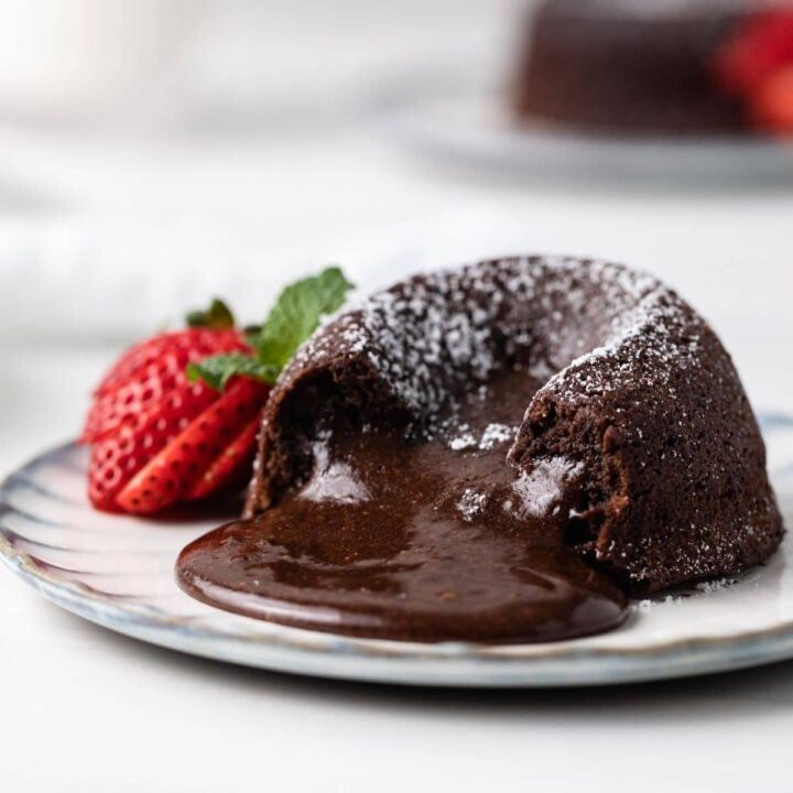side view of chocolate lava cake with the molten middle spilling out