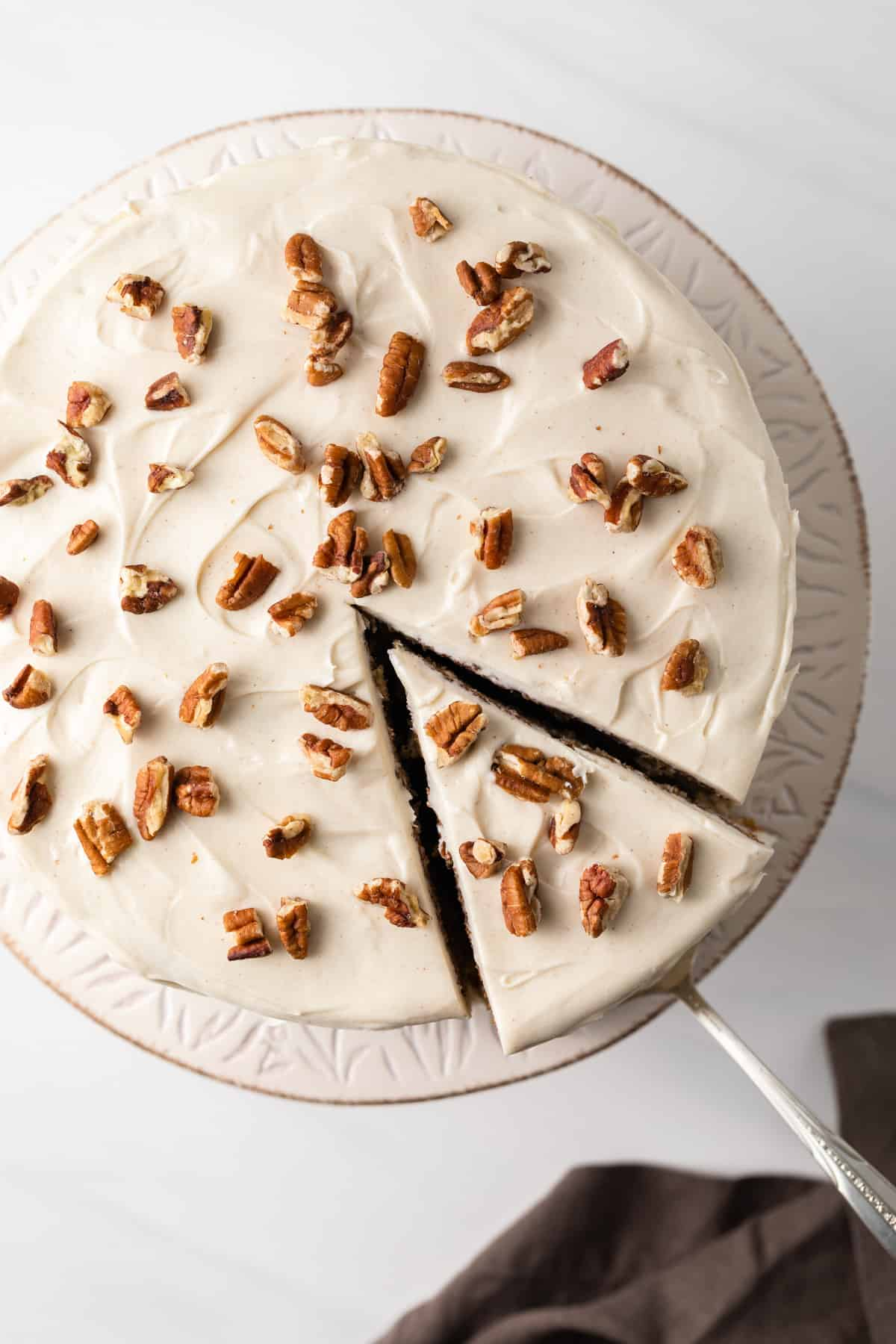 overhead of hummingbird cake with slice being taken out