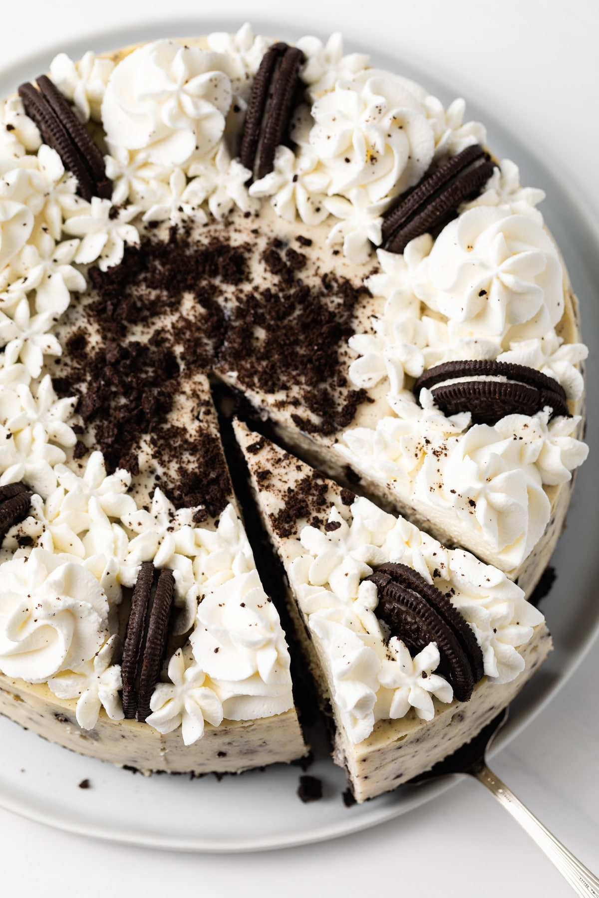 close up of oreo cheesecake with a slice being taken out