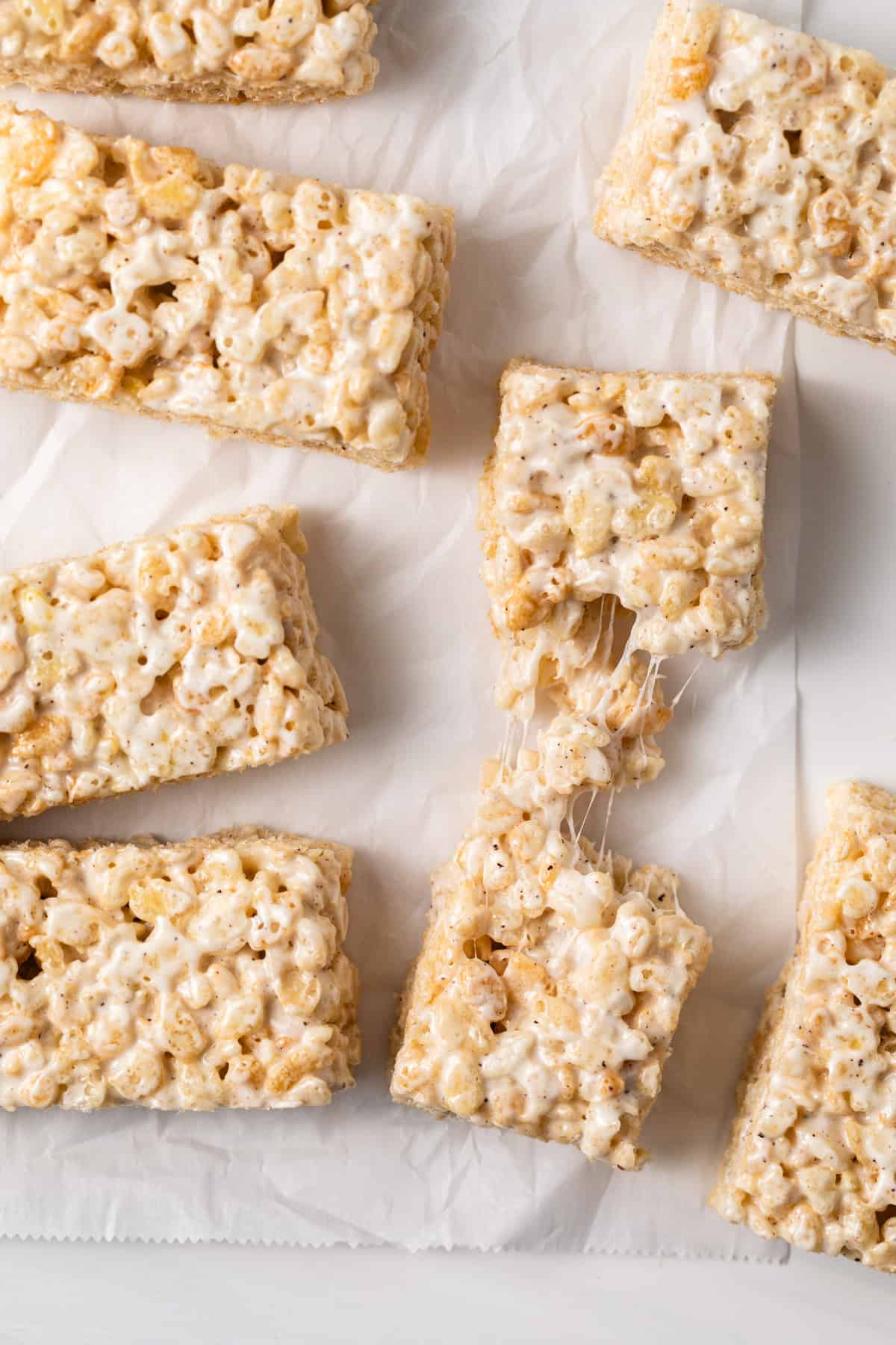 rice krispie treats with one pulled apart to show how gooey it is