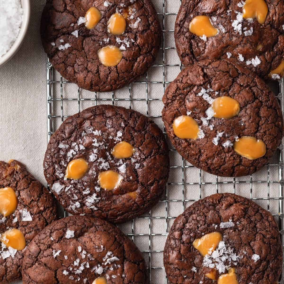 brownie cookies with salted caramel on a wire rack