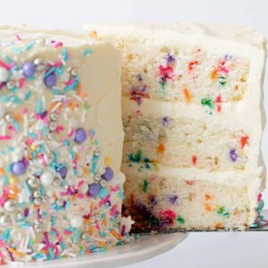 Funfetti cake with slice being taken out.