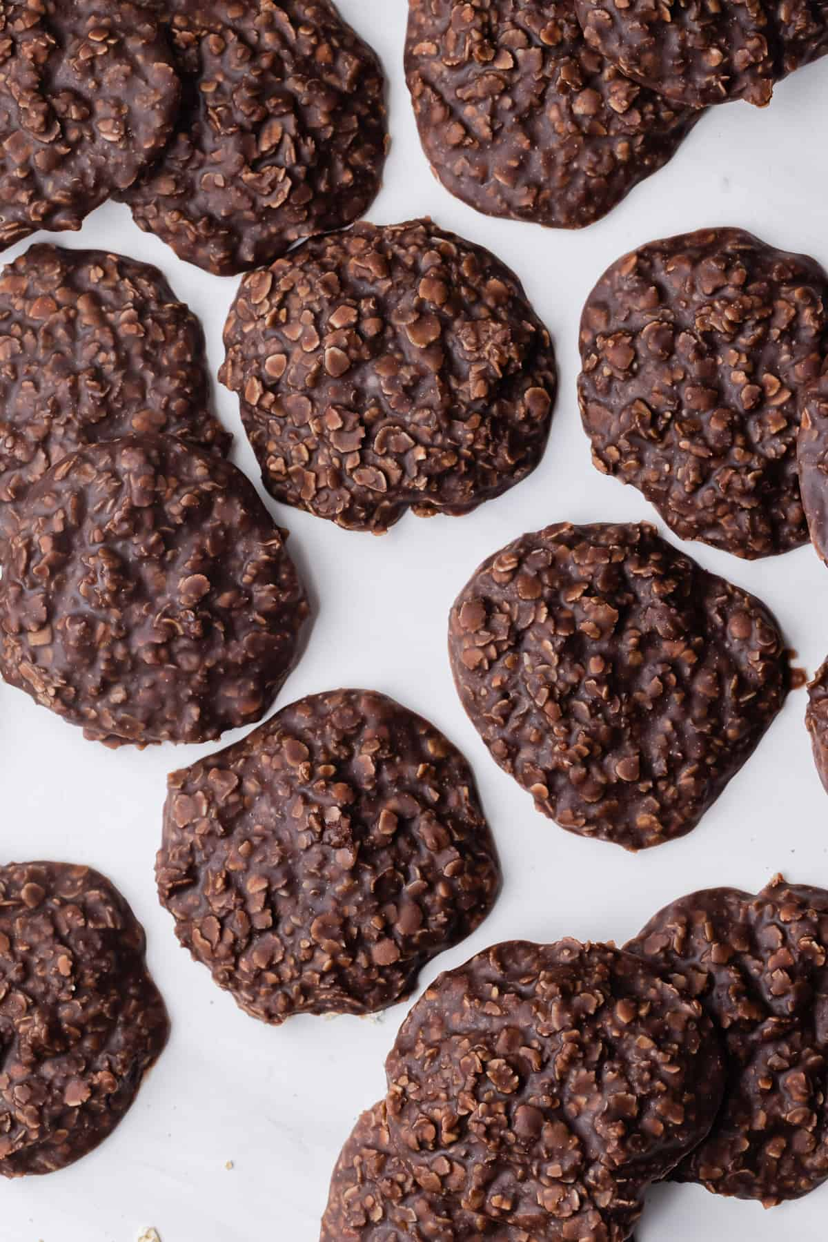 No bake oatmeal cookies on white background.